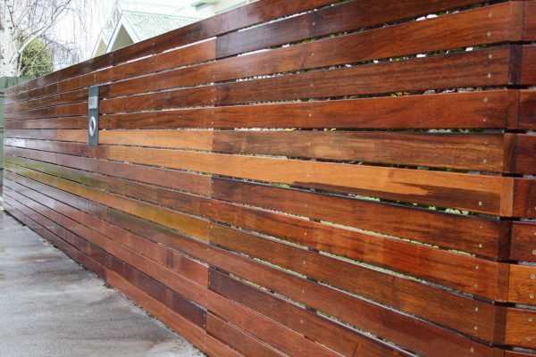 90/19 Merbau slat fence built on arc due to court location