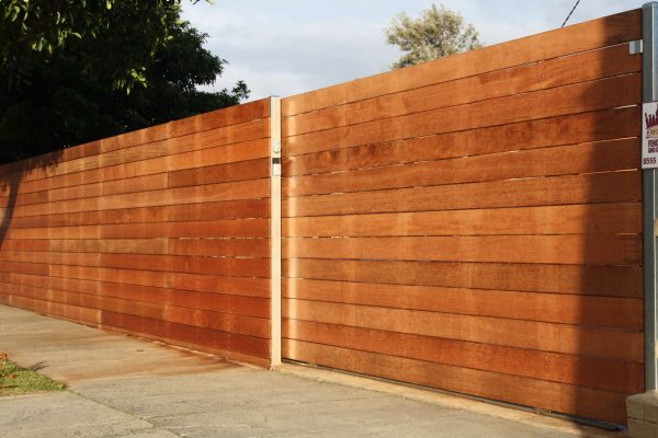 140/19 Merbau Slat fence with concealed Galvanized posts with Sliding gate