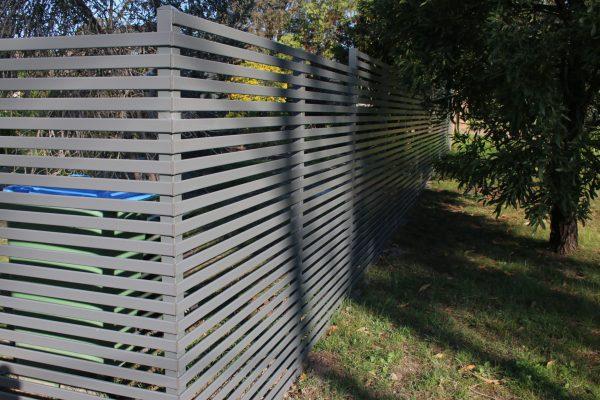 Gramline Smartslat fence using 40mm wide slats