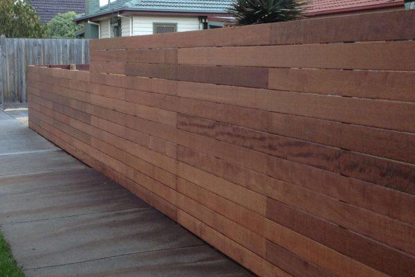 Horizontal Merbau slat fence with close spacing