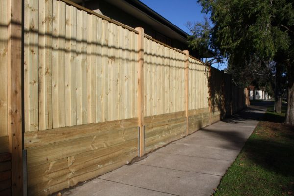 Treated Pine paling fence with Sleepers fitted underneath to retain soil.