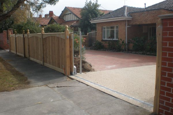 Sliding Gate with Cypress pickets and Feature Arch boards