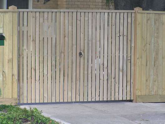 Double Gates clad with Treated Pine decking and Gabled Lipped Capping