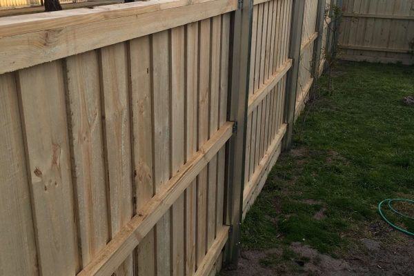 Galvanized Steel posts in Treated Pine Paling fence