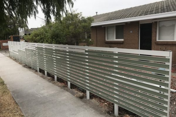 Gramline Smartslat fence partially completed. Shows 2 part slat to hide fixings