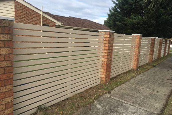 Smartslat fencing between brick piers. 80mm Smartslat with 20mm gaps