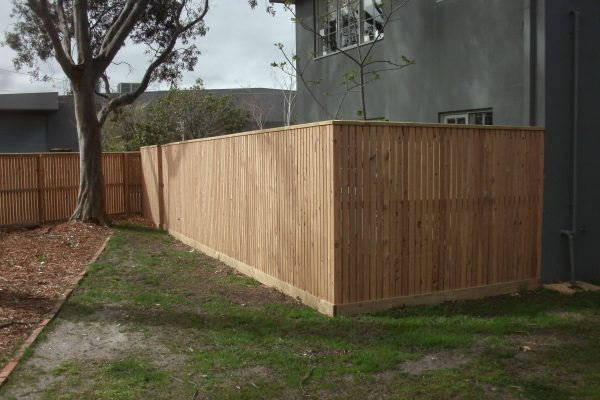 Cypress Picket fence with Gabled Lipped Capping and concealed posts - corner view