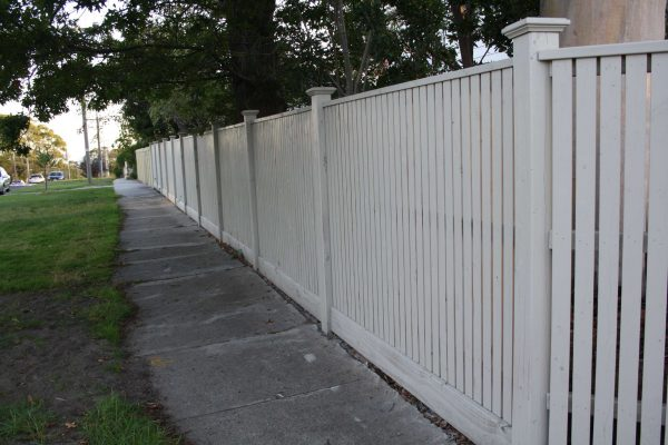 Feature Picket fence with Exposed Posts and Post caps and Gabled Lipped Capping