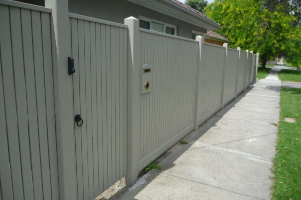 Picket fence with Exposed posts and Gabled Lipped Capping