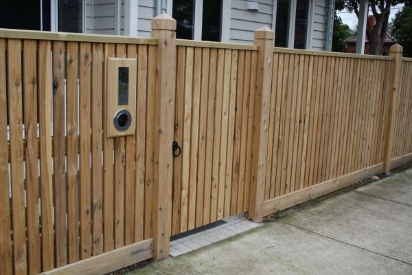 Picket fence with Exposed posts and Gabled Lipped Capping. Single gate clad to match