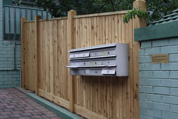 Feature Picket fence with Exposed posts and Gabled Lipped Capping. Letterbox bank fitted into front fence
