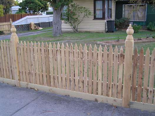 Low Picket fence with Exposed posts and Capitols